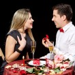 Man proposing marriage to a surprised woman — Stock Photo #71423253