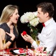 Man proposing marriage to a surprised woman — Stock Photo #71423325