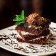 Chocolate brownie cake with a scoop of ice cream. — Foto de Stock   #73297363