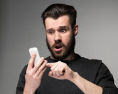Portrait of man talking on the phone — Stock Photo