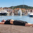 Girl and yachts on the coast of Saint Tropez, France — Stock Photo #76041723