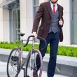 Handsome businessman and his bicycle — Stock Photo #76165611