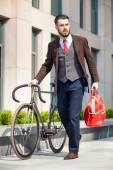 Handsome businessman and his bicycle — Stock Photo