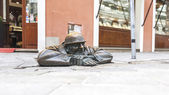 Bratislava, Slovakia - May 07 2013 Cumil  famous statue of man peeking out from under a manhole cover. — Stock Photo