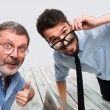 Постер, плакат: Two colleagues taking the picture to them self sitting in office