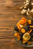 Dried fruits in a wooden bowl. — Стоковое фото