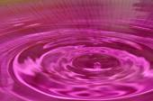 Water droplets on a purple background — Stock Photo
