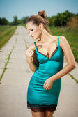 Sexy young woman posing outdoors — Stock Photo