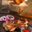 Delicious steak with chili sauce and chopped onion rings — Stock Photo #71272901