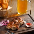 Delicious steak with chili sauce and chopped onion rings — Stock Photo #71716117