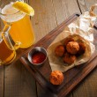 Cheese balls with spicy sauce in paper — Stock Photo #71716753