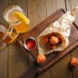 Cheese balls with spicy sauce in paper — Stock Photo #71720169