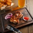Delicious steak with chili sauce and chopped onion rings — Stock Photo #71724163