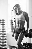 Woman blond bodybuilder — Stok fotoğraf