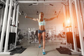 Strong woman doing exercise in the gym — Stock Photo