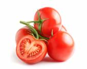 Fresh tomatoes on a green stem — Stock Photo