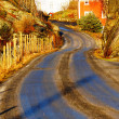 Road is covered by ice and topped with gravel — Stock Photo #61829103