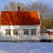 White wooden house with a red roof — Stock Photo #63842685