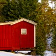 Red wooden house on the tool — Stock Photo #63842715