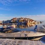 Luxury motor boat moored in the harbor in winter — Stock Photo #63847021