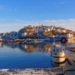 Motor boats moored in the harbor in winter — Stock Photo #63847025