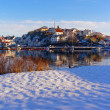 The beach on the shores of the harbor under the snow — Stock Photo #63847031