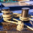 Gray ropes tied to cum on the fishing boat — Stock Photo #63847159