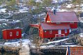 Red fishing cottages on the bay — Stock Photo