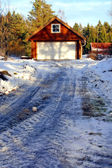 Icy road to the wooden garage — Stock Photo