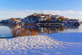The beach on the shores of the harbor under the snow — Stock Photo