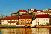 Colored and white houses port — Stock Photo