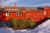 Big red barn with wooden wall decor — Stock Photo