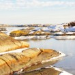 Folded rocks covered with snow fjord — Stock Photo #64795767