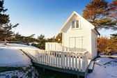 Tall and very thin white cottage — Stock Photo