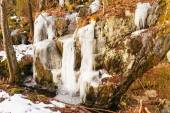 Ice overhangs on rocks — Stock Photo
