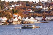 Rocky island with buildings in fjords, Norway — Stockfoto