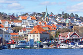 Historical buildings on coast fjords — Stock Photo