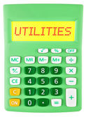 Calculator with UTILITIES on display on white — Stock Photo