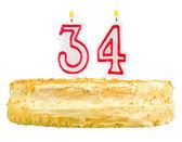 Tort urodzinowy z świece numer trzydzieści cztery — Zdjęcie stockowe