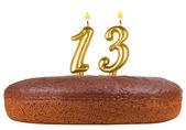 Birthday cake with candles number 13 isolated — Stock Photo