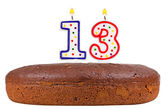 Birthday cake with candles number thirteen — Stock Photo