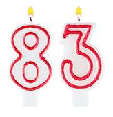 Świeczki na urodzinowym torcie numer osiemdziesiąt trzy — Zdjęcie stockowe