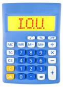 Calculator with I.O.U. — Stock Photo