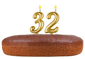 Birthday cake candles number 32 isolated — Stock Photo