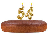 Birthday cake with candles number 54 isolated — Stock Photo