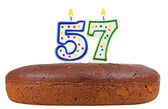 Birthday cake with candles number fifty seven — Stock Photo