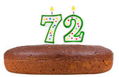Birthday cake with candles number seventy two — Stock Photo