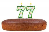 Birthday cake with candles number seventy seven — Stock Photo