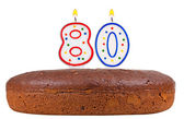 Birthday cake with candles number eighty isolated — Stock Photo