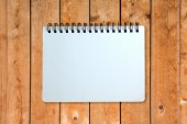 Opened-notebook on wood pattern — Stock Photo